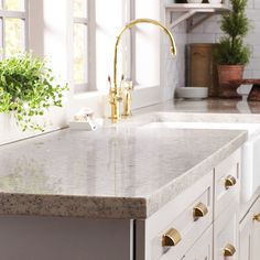 How much would you have to spend on countertops for a kitchen remodel like this one? The Home Depot's Countertop Estimator  Calculator helps you stay on budget.