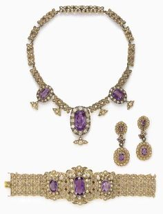 A SUITE OF ANTIQUE AMETHYST, DIAMOND AND GOLD JEWELRY Comprising a necklace, set to the front with three cushion-cut amethysts, each within an old mine-cut diamond surround and suspending a foliate old mine-cut diamond terminal, to the old mine and rose-cut diamond floral necklace; a bracelet and pair of ear pendants en suite, mounted in gold, circa 1880