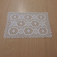 A very cute looking little white doily, can be used as a coaster. With a simple hexagon design, it will be great as a gift.  Color: White  Dimensions: