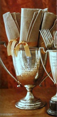 antique trophy's with cutlery and napery. Horse Country Chic