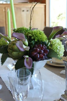 Inspiration for fall centerpiece . Use artichokes,grapes and hydrangeas