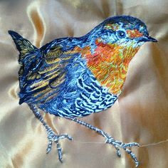 Chucao ( a little bird from the south of Chile) embroidered over fabric.