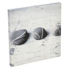 Set off a dark blue feature wall with this pebble canvas print set to really set the theme