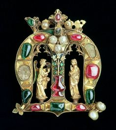 The Hylle Jewel, in the form of a crowned Lombardic initial 'M' with annunciation figures, late 14th century.
