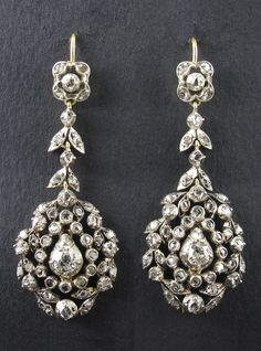 A pair of antique silver, gold and diamond earrings, probably Italian, late 19th century.
