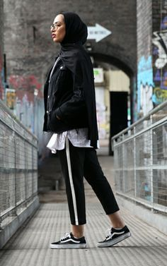 ▪PINTEREST: Aya MB• | black jersey hijab/scarf + white shirt + oversized black raw hem denim jacket + black cropped pants with white running stripe + black vans sneakers