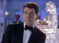Pierce Brosnan as James Bond wearing a Brioni tuxedo