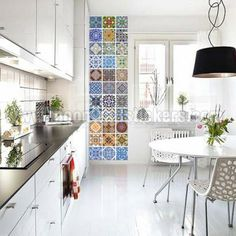 Portuguese Tiles Azulejos Stickers.  I love the look of this wall of tiles, whether stickers or real tiles.  This is absolutely stunning.