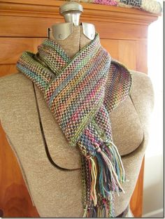 """Kristin at Cozy Things gives a recipe for a Linen Stitch Scarf, saying: """"It's wild, but only when you really look at it up close.  Otherwise, it seems kind of subdued, vaguely colorful, just interesting."""" This one is sock yarn leftovers. Also a great use for any scattered-color or short-change yarn like Koigu. How is it that linen stitch makes almost anything look elegant? Watch out for the stiffness, though - swatch just to test the drape!"""