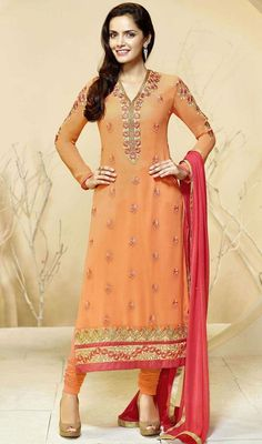 Redefine ethnic stylishness in this Indian churidar suit, georgette fabric in orange color. This enticing attire is showing some terrific embroidery done with lace, resham and stones work. #lateststraightdress #eveningweardresses #onlinedresscollection
