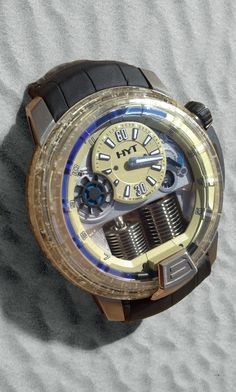 HYT Watches H1 Sand Barth Watch - see more about this watch with sand from St. Barth island inside it (on purpose) in Ariel's write-up over at Departures Magazine - then see more hydromechanical creations creations from HYT, including the new Skull Watch, released just yesterday: http://www.ablogtowatch.com/watch-brands/hyt/