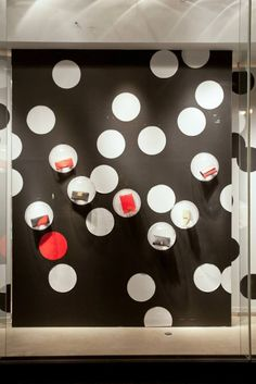 Color:Black,White,and Red, Balance:Asymmetrical (informal), Emphasis:spotlight on the purses, Rhythm:the white dots that's around the display