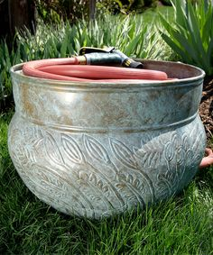 garden hose pot - would love something like this over our impossible to use hose-reel :)