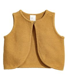 Check this out! BABY EXCLUSIVE/CONSCIOUS. Vest knit in a garter stitch in soft organic cotton. Round neck and one button at neckline. - Visit hm.com to see more.