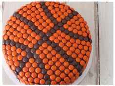 Basketball cake w/ reeses pieces? So gonna do this for my Hoops party this evening!