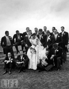 Ted Kennedy, John F. Kennedy, and Robert F. Kennedy, along with the groomsmen, surround bride Jacqueline Bouvier at her 1953 wedding to JFK.