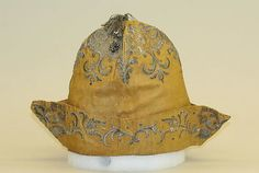 Cap Date: early 18th century Culture: Italian Medium: silk, metal Dimensions: Width (lower edge of brim): 11 1/2 in. (29.2 cm) Height: 8 3/4 in. (22.2 cm) Credit Line: Isabel Shults Fund, 1986 Accession Number: 1986.106.13