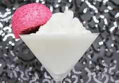 SNOWTINI...Makes 2 - 1/3C coconut cream (should be settled at the top of a can of coconut milk),¼C marshmallow creme, 3 tablespoons vanilla vodka,3 tablespoons white chocolate liqueur,2 tablespoons half ,1 miniature bottle of Malibu rum, ¼C coconut,2-3 tablespoons sugar,1/8 teaspoon salt, Ice, 1 package of Hostess Snoballs to garnish--Add all ingredients to blender and blend, Baby, blend!!!  Keep adding ice until you get a nice, slushy, snow-like consistency.  Garnish with Snoballs!