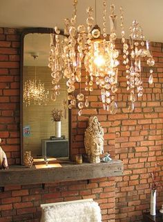 love the chandelier light reflecting in the wall mirror