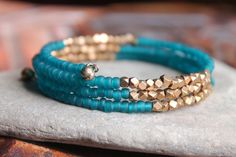 Kalimantan Stacking Memory Wire Bangle Bracelet with Matte Teal Glass and Faceted Brass Beads - Exotic and Chic