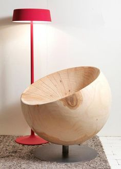 this chair is made out of a single block of solid scented cedar wood that is turned on a lathe