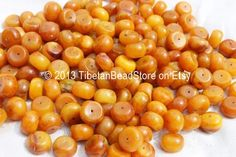 Etsy listing at https://www.etsy.com/listing/162455824/10-beads-tibetan-small-amber-beads