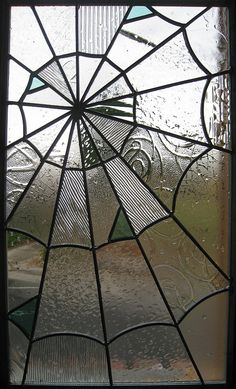 Spider woman/Arachne: spider web looking stained glass