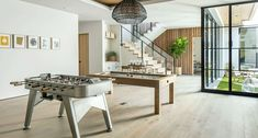 Coastal contemporary home celebrates indoor-outdoor living in California Indoor Outdoor Living, Outdoor Dining, Dining Area, Wall Of Light, Hanging Wood Shelves, Home Still, Wood Front Doors, Minimalist Interior, Lounge Areas