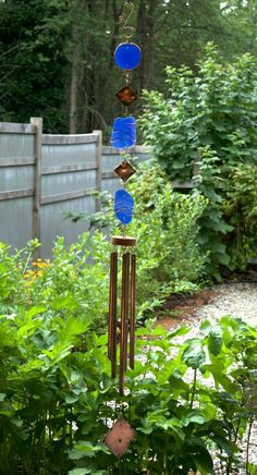 This beautiful glass and copper wind chime measures 55 inches long from the top of the copper hook to the bottom of the hammered copper windsail. The 3 attractive cobalt blue pieces of artist-made bea
