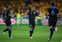 Theo Walcott celebrates drawing England level against Sweden