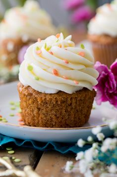 A Carrot Cake Cupcake Topped off with a cream cheese frosting swirl