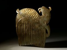 """Chinese phoenix jade comb (2)   Creative-museum. Jade comb depicting a stylized, mythological phoenix. The phoenix was an emblem for the women of the royal family, and could be buried along with the dead. China, Qing dynasty (1644-1911), 3 3/8 x 3 3/4"""""""