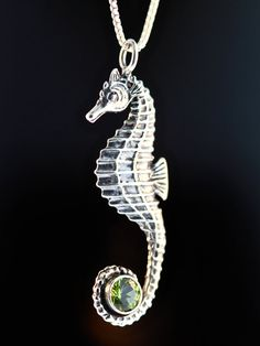This graceful solid sterling silver Seahorse Charm is 1 3/4 high and completely detailed both front and back. It has a 6 mm Blue Topaz set in the curl of its tail. It is also available with an amethyst, peridot, citrine, or garnet for the same price. Swim away with this whimsical underwater creature.  All Marty Magic Charms and Pendents include an 18 inch (46cm) box chain. If you would prefer a different length of chain please feel free to contact me.  This item usually ships the same or…