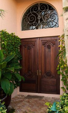Love these double wood doors. I just don't like the idea of glass on my front door than can be smashed in and the door unlocked. I want a strong sturdy door. Double Front Entry Doors, Iron Front Door, Glass Front Door, Glass Door, Exterior Entry Doors, Entrance Doors, Garage Doors, Arched Windows, Windows And Doors