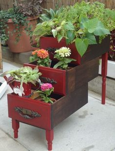 Love the 3 tiers in this cute planter made from drawers!  What a conversation piece!