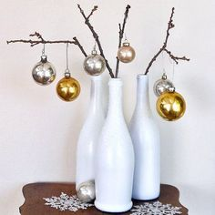 Easy Holiday DIY: Winterized Wine Bottles: If you're tight on space, but still want to display some holiday spirit, save your wine bottles to use as Winterized vases that look lovely on their own or filled branches as a mini tree. Diy Christmas Decorations Easy, Holiday Crafts, Christmas Holidays, Christmas Trees, Holiday Tree, Xmas, Deco Table Noel, Empty Wine Bottles, Christmas Wine Bottles