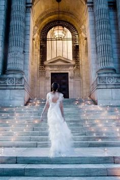 Amazing idea of making the steps to the church into a twinkling aisle with candles for a dusk ceremony.