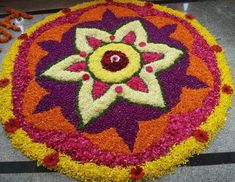 Here are some very beautiful flower rangoli designs for Diwali, Onam, Pongal, and Durga puja. Flower rangoli are easy to make and very gorgeous to look at. Rangoli Designs For Competition, Rangoli Designs Flower, Rangoli Designs Diwali, Rangoli Designs Images, Beautiful Rangoli Designs, Rangoli Colours, Rangoli Patterns, Rangoli Ideas, Onam Pictures