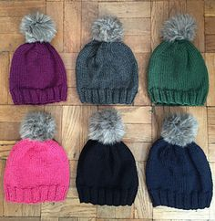 A super soft chunky classic knit hat with giant faux fur pom-pom.