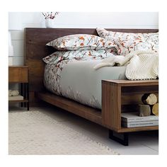 I Love this bed. It looks like it's made of old barnwood. The bookcase at the end serves as storage and a place to sit and put your socks on!