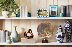 How to STYLE a bookcase 2016 via OKL Step 1: Start with Something Tall  Step 2: Add (Beautiful) Books Step 3: Give Each Shelf Structure (just one impactful object per shelf: This will serve as your anchor as you build out each shelf vignette..a potted plant will do!) Step 4: Fill Out the Space (a momento or two...Be sure to overlap some objects and place some at a slight angle. The result will be a more natural-feeling, less-fussy look.) OKL #our1928Home