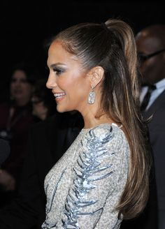 Jennifer Lopez Half Up Half Down Jennifer Lopez wore her hair in a simple half up, half down style at the 2011 American Music Awards post party.