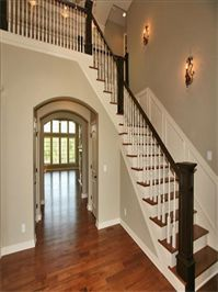 Custom entry and staircase design by Stovall Construction.