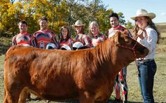 Canadian luge team visits a cow.