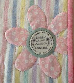 Shirley Sherrat did this...a label is a neat quilt accessory.