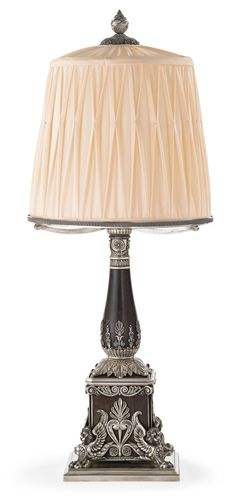 """A Fabergé Silver and Wood Presentation Lamp, Workmaster Karl Gustav Hjalmar Armfelt, St. Petersburg, circa 1900-1906, the square wood base with silver winged lions at the corners, the sides applied with anthemia, the baluster stem rising from acanthus leaves, the square base engraved in Cyrillic """"To Baron E. IU. Nolde from the Office of the Committee of Ministers"""". Provenance: Baron Emmanuel Iulievich Nolde, later Collection of Lily and Edmond J. Safra."""
