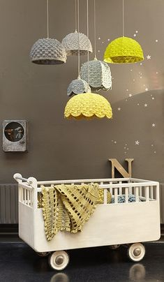 This makes me want babies... Love this idea :)   Paint some wicker baskets (Martha Stewart has fantastic paints at Michael's), flip them upside-down, drill a hole & fasten a light through it (great deals at IKEA) & you have these! Or you can hang them without the lights! - in-the-corner