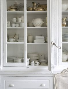 white cupboard, white dishes, white chair, old silver