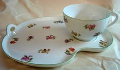 Decorative Dishes - (http://www.decorativedishes.net/vintage-nippon-fine-china-sweet-flower-cup-tray-snack-tennis-tea-set/)
