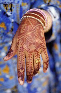 Young Shiddi woman's henna tattooed hand. Pakistan
